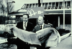 Ray Kroc and Fred Turner looking at blueprints of future McDonald's restaurant