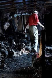 Ray Carter assessing the damage from a house fire in Chicago