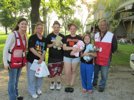 Red Cross volunteers assist a family in Will County after they experienced a home fire.