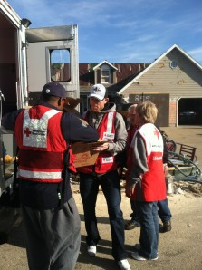 20and Robbie Gould and former player Rashied Davis unload supplies from the Red Cross emergency response vehicle.