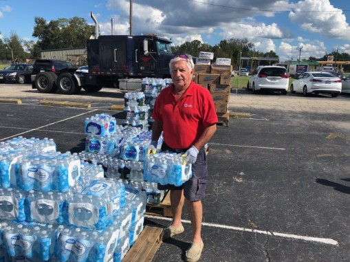 geoff f by water bottles.jpg
